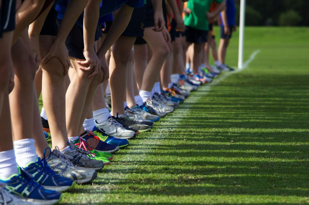children lining up to start a cross country race